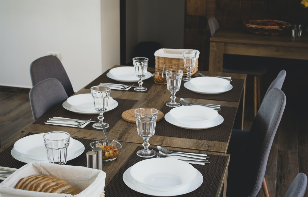 brown wooden table on white ceramic plates