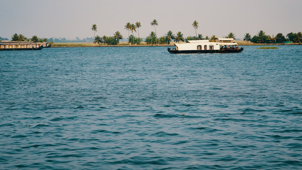 boat on body of water in front of island