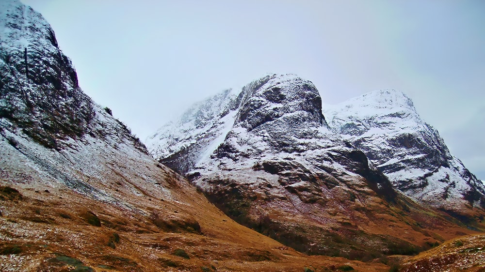 selective focus photography of mountain covered snow