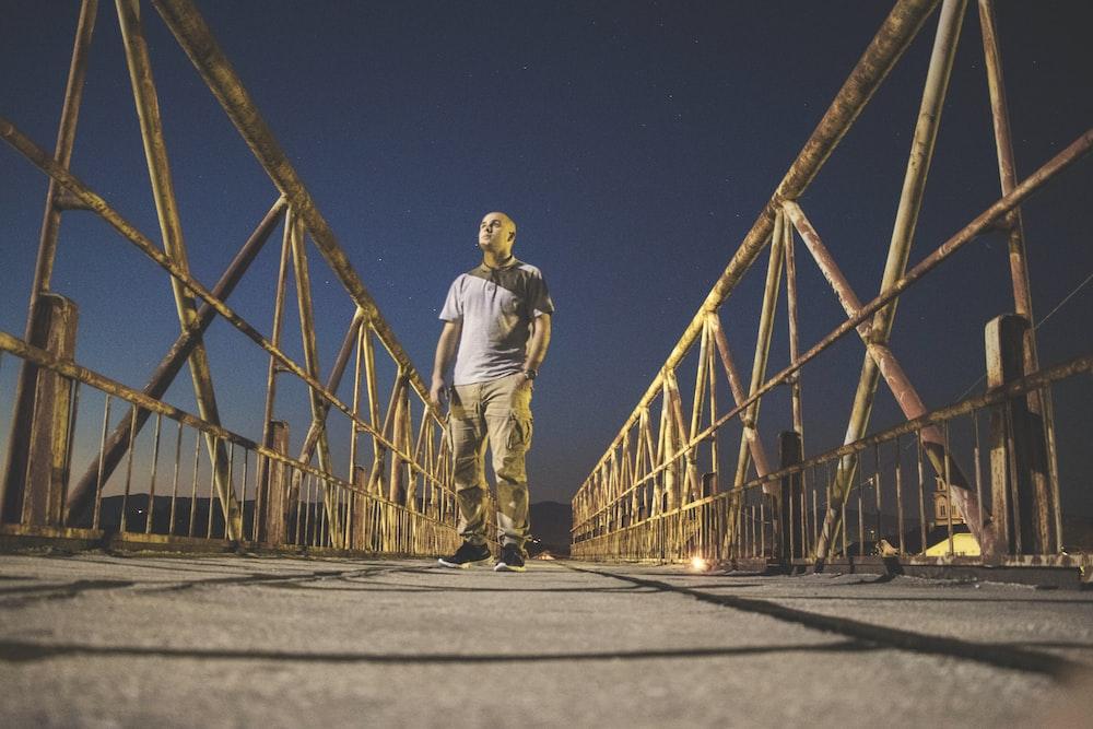 man walking down the bridge