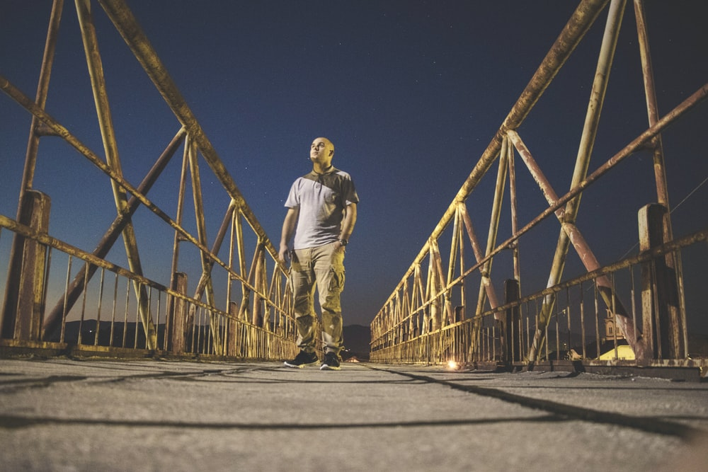 man walking down the bridge