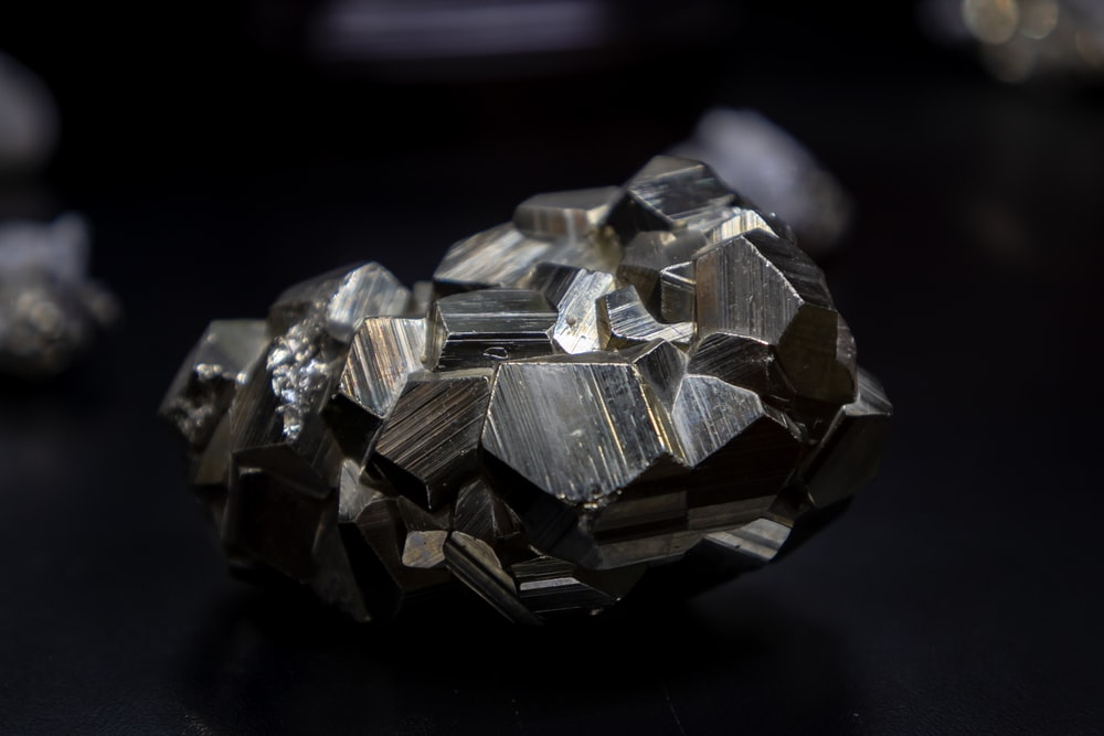close up photography of gray stone on black surface