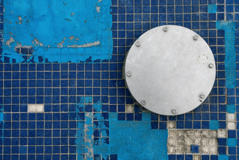 round gray metal board