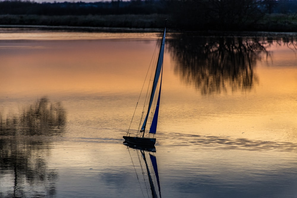 a sailboat in the middle of a lake
