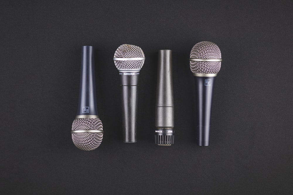 four black microphones
