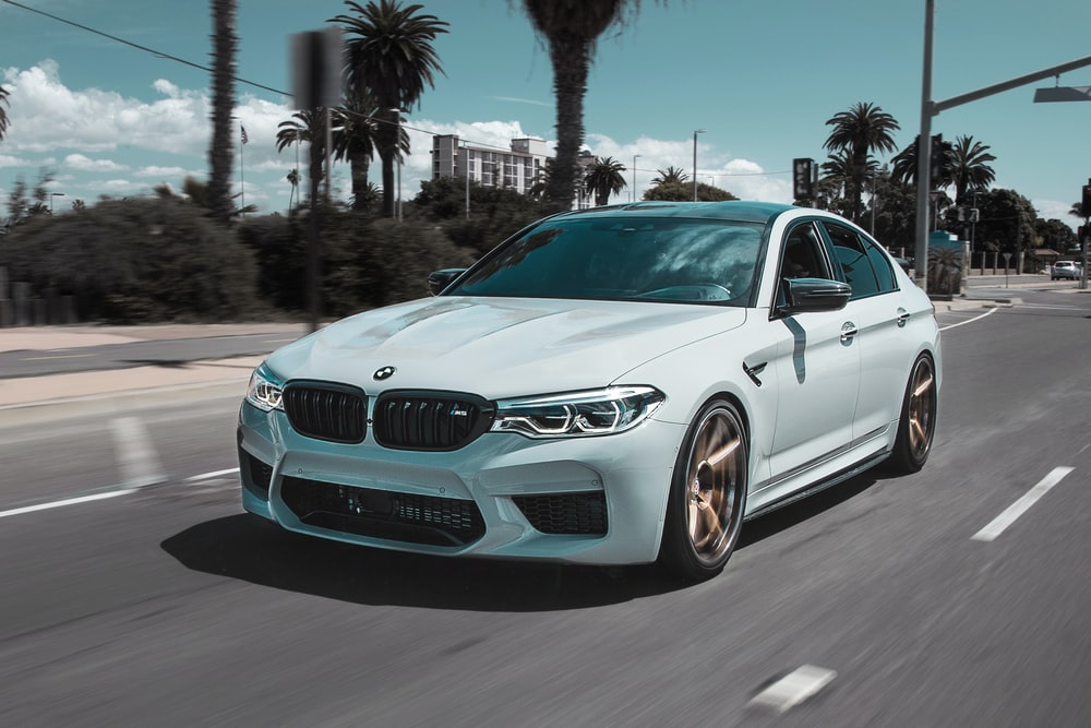 white BMW car on street