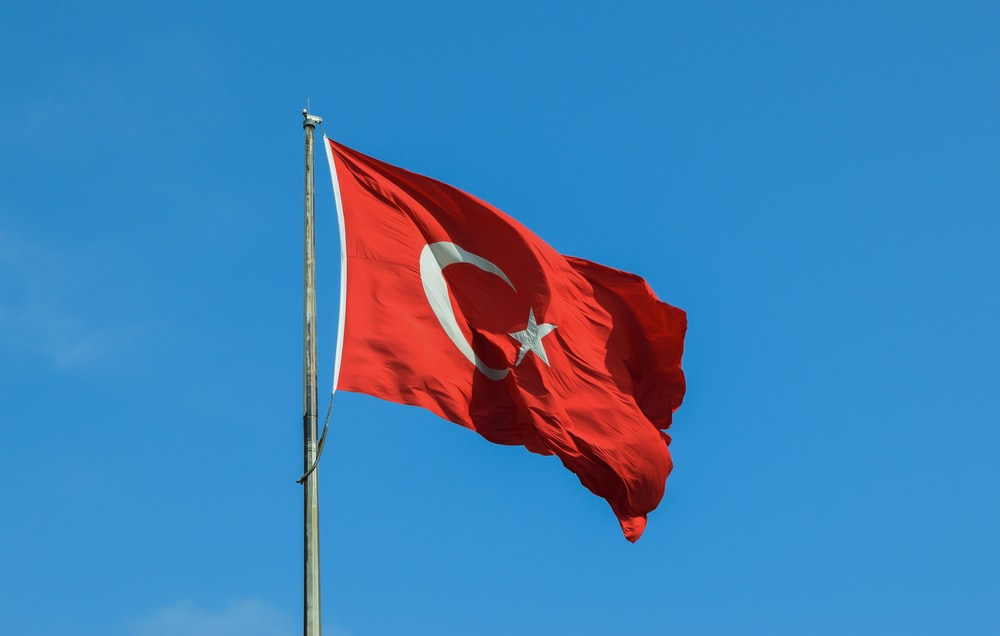 red and white national waving flag