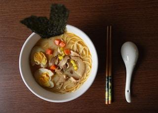 ramen platter beside chopsticks and ladle