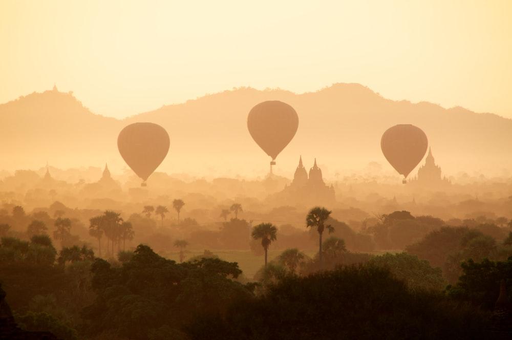 three air balloon during daytime