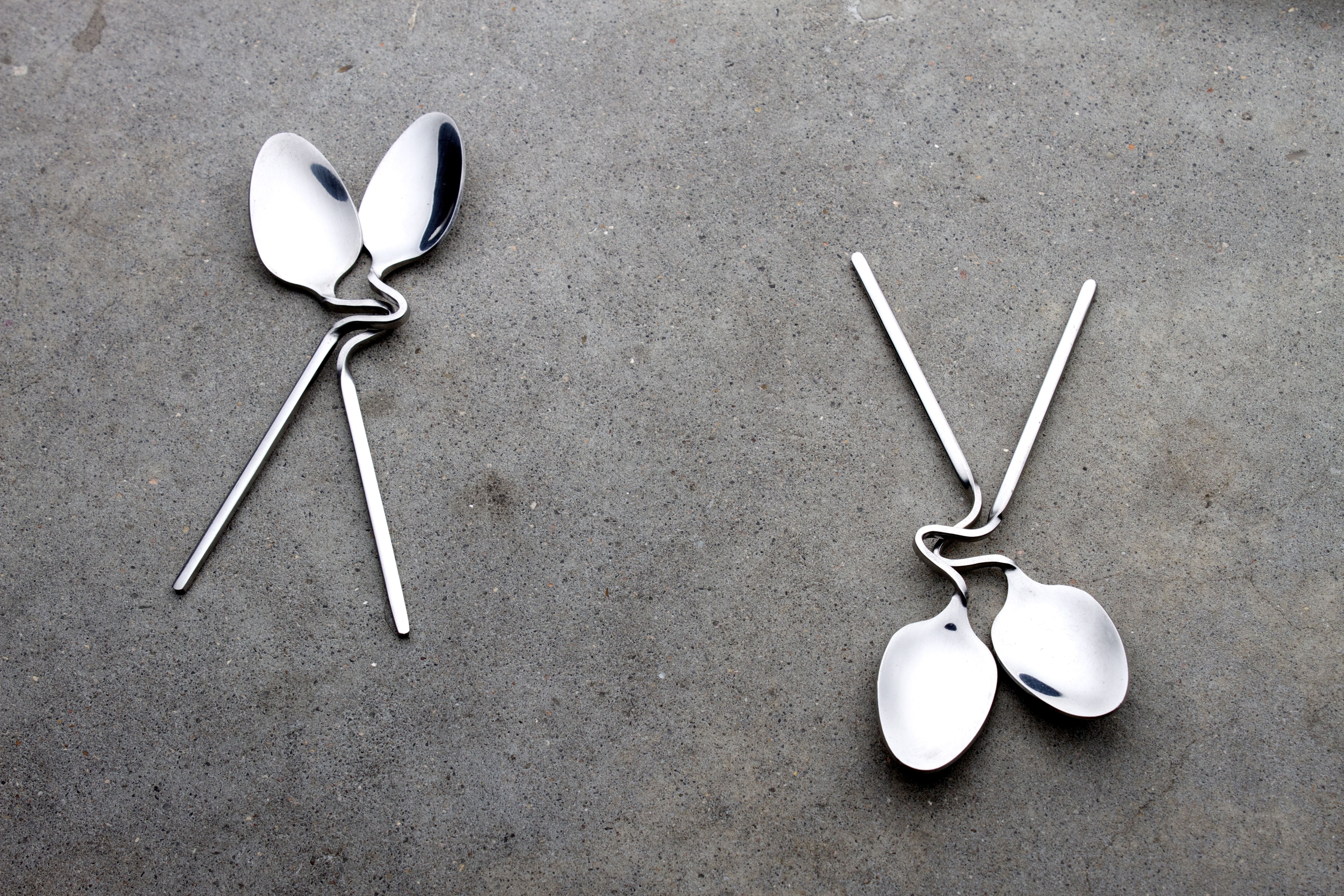 two grey stainless steel spoons