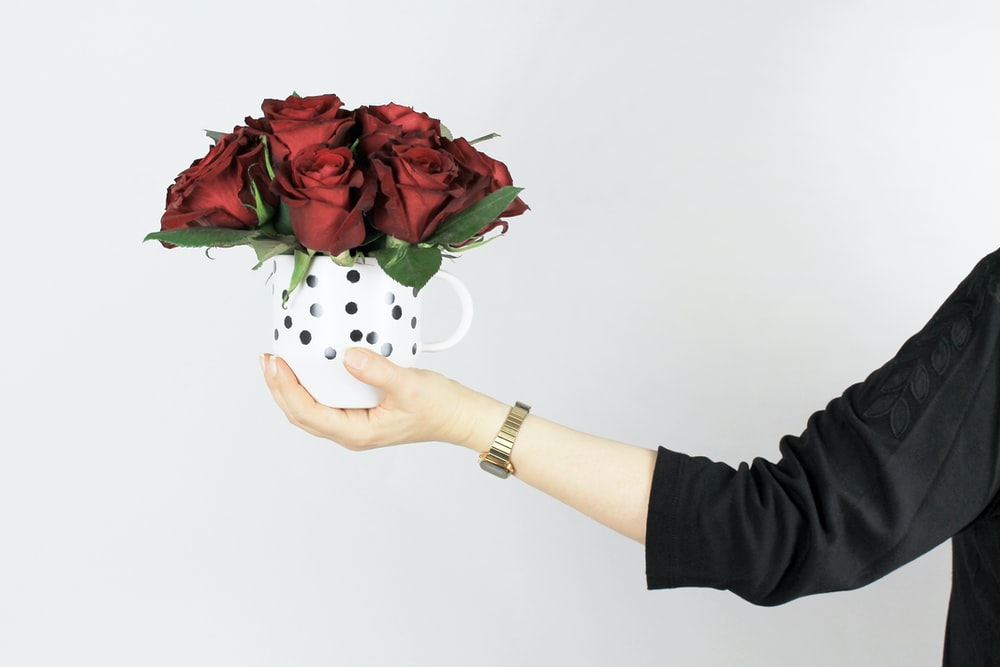 red rose arrangement on mug