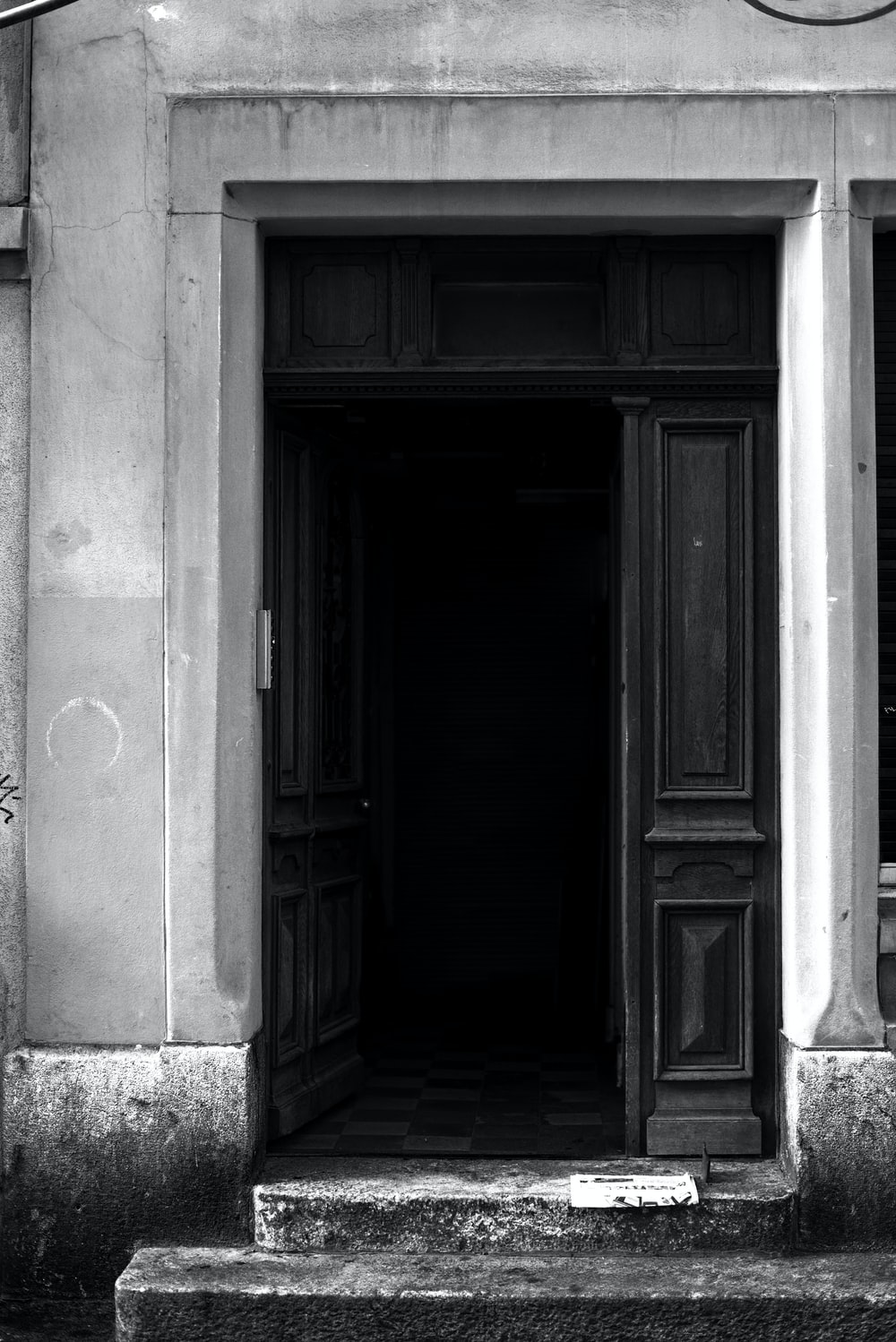 grayscale photography of door