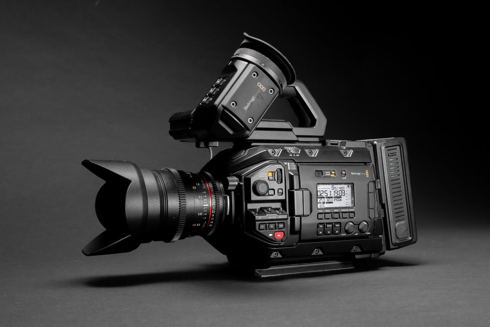 selective focus photography of black videocorder camera