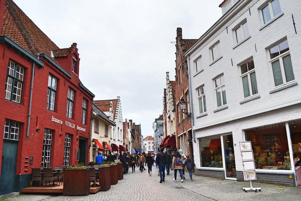 people at the street between buildings