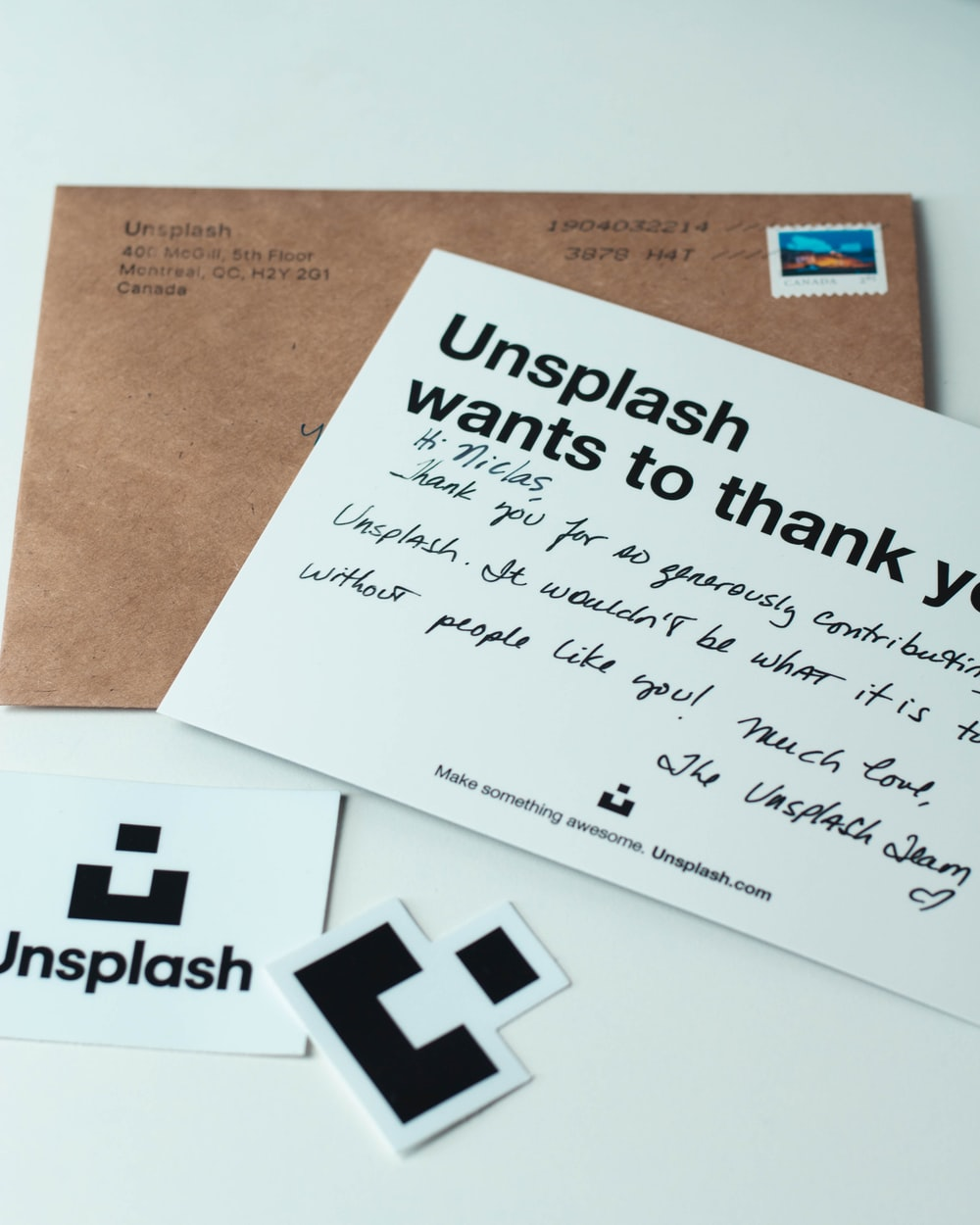 two brown and white Unsplash wants to thank you letter