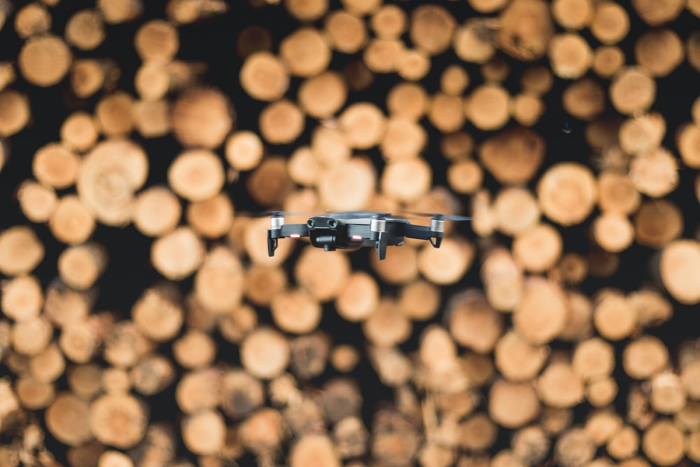 grey and black quadcopter bokeh photography