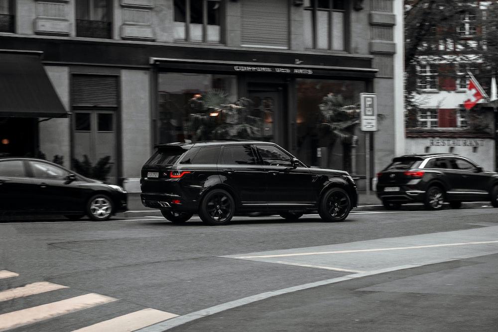 black SUV near the building