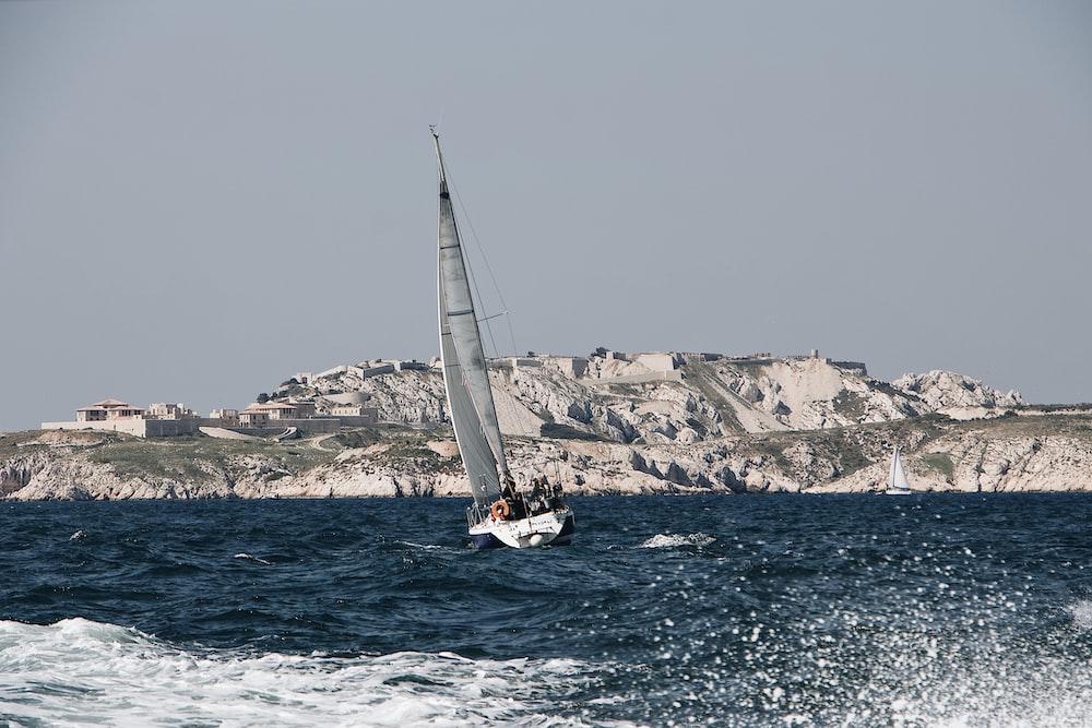 white sailboat on ocean