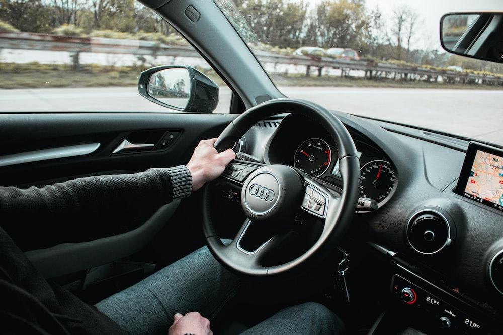 man riding inside car
