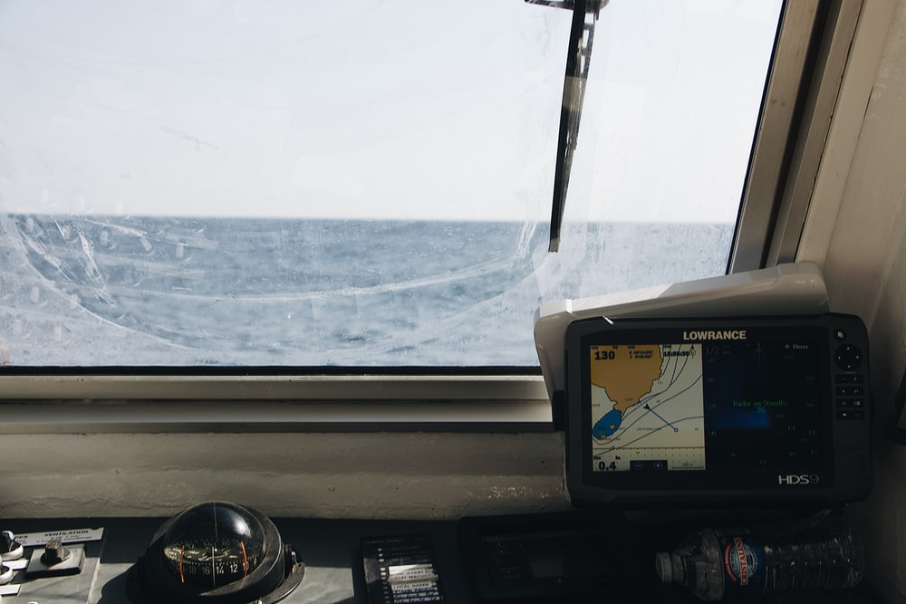 boat with black Lowrance GPS turned-on
