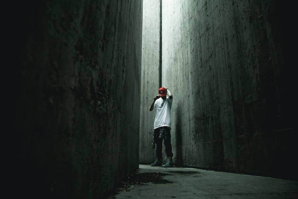 man standing on concrete ground