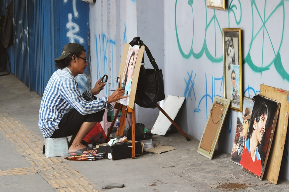 man painting woman