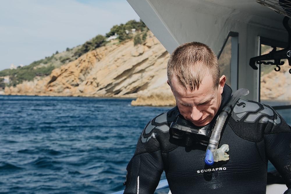 man wearing wet suit