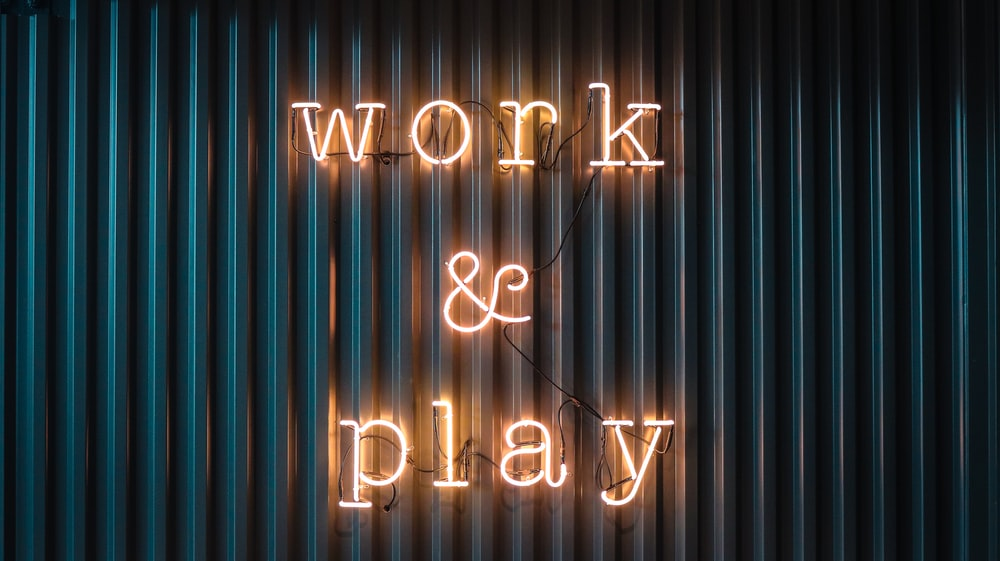 Work and Play yellow neon sign