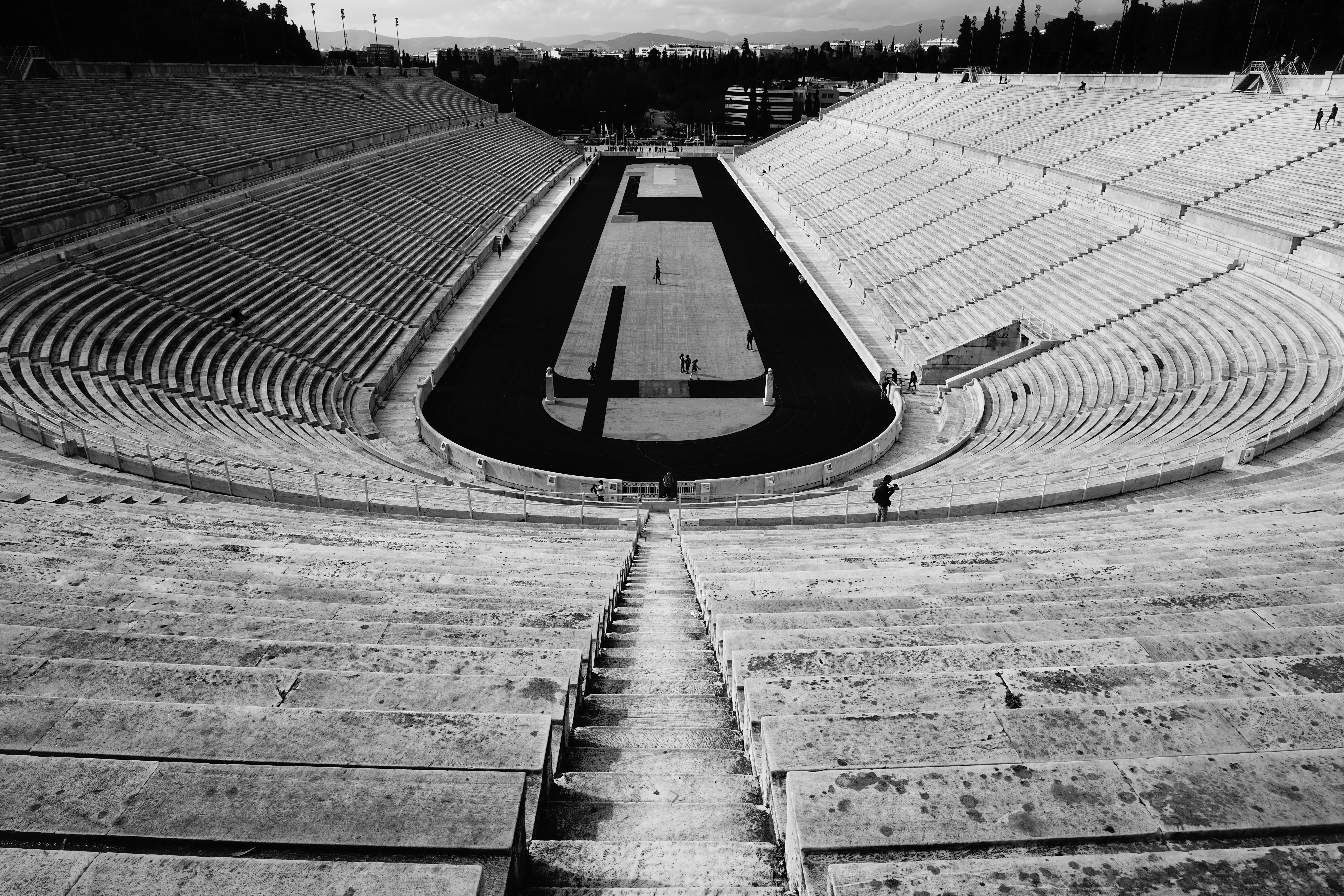 grayscale photography of stadium
