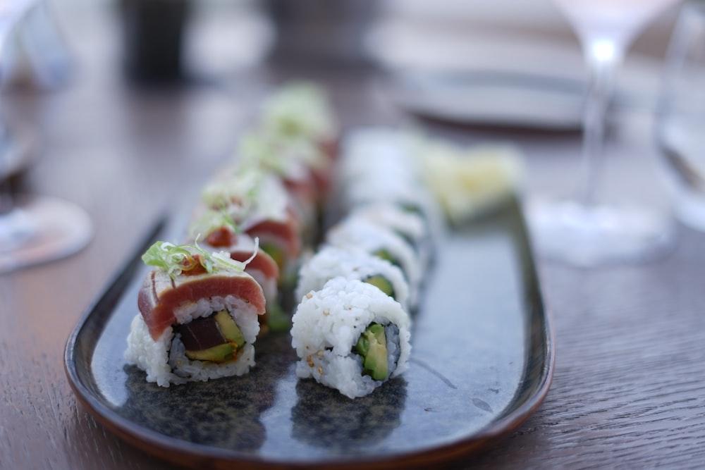 sushi plates on gray platter