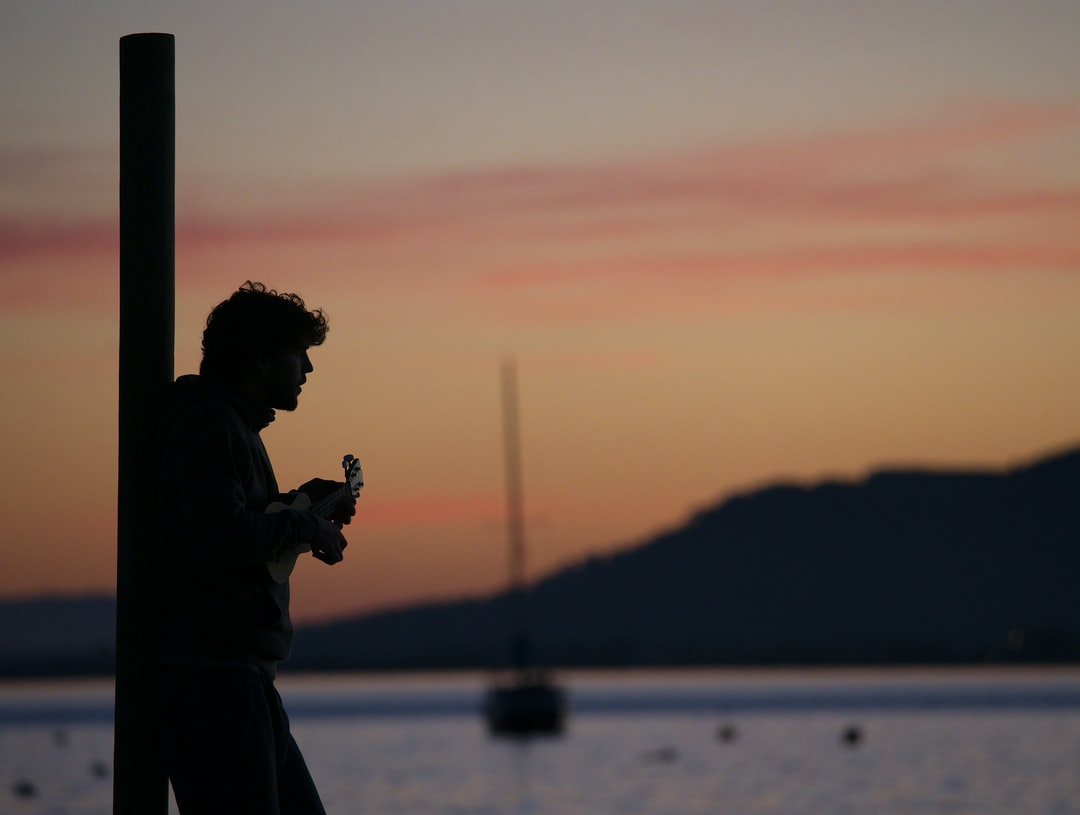 Guitar player at sunset - Port de Pollença, Spain