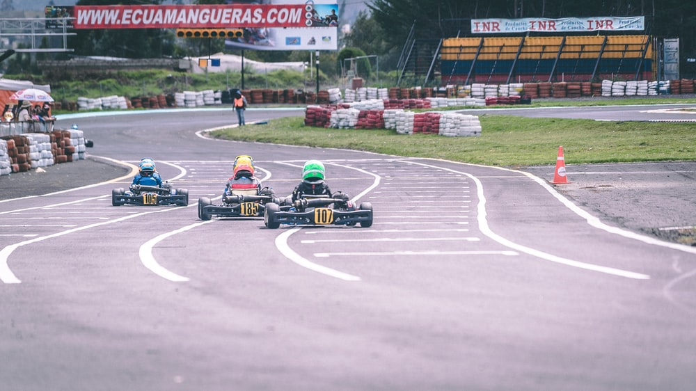 man riding go-karts in race track