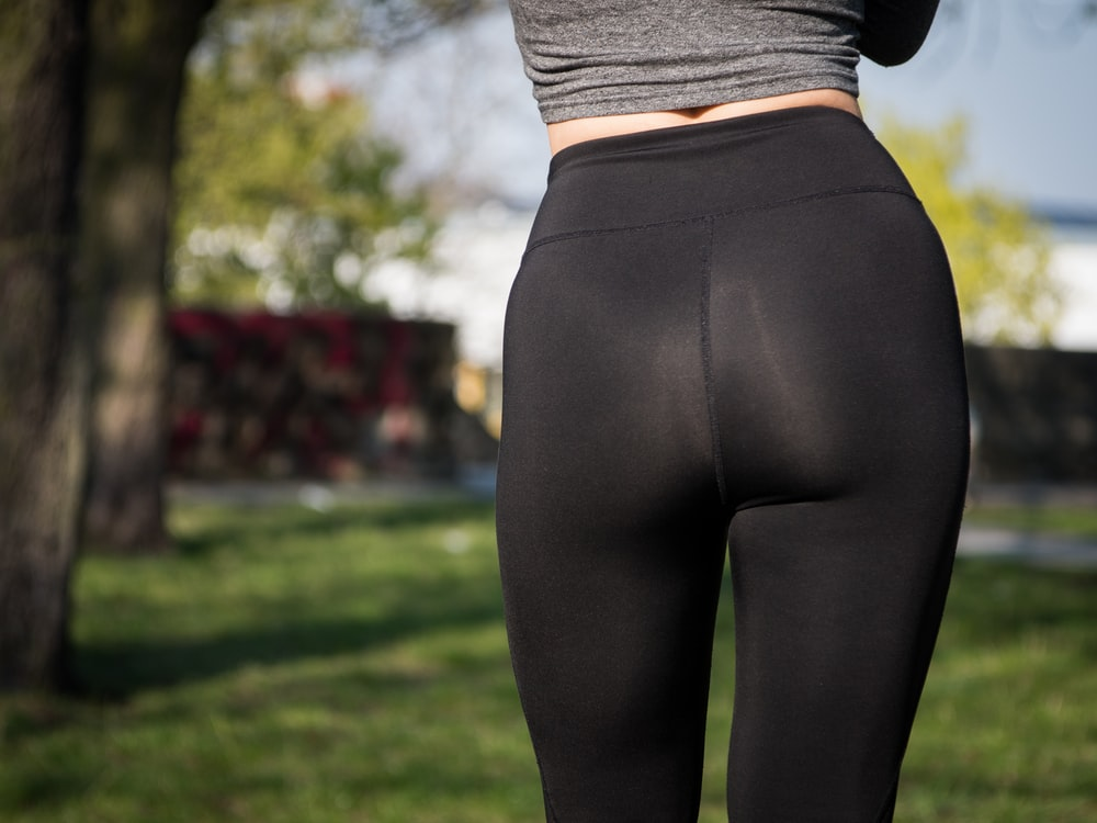 woman wearing black bottoms