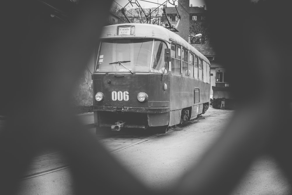 grayscale photography of cable car
