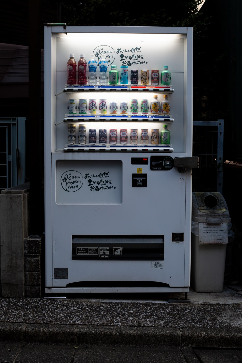 white vending machine with lights turned on