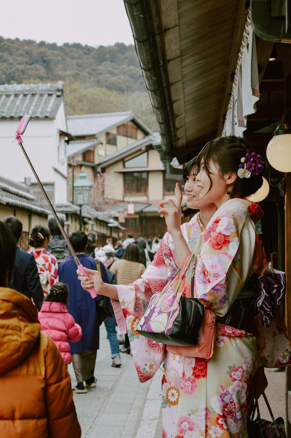 two woman yukata dress during daytime