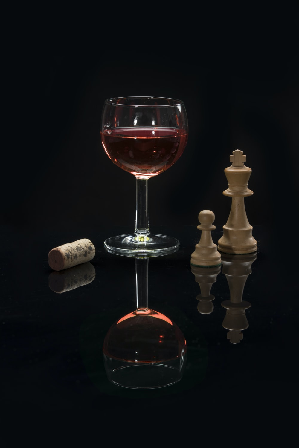long stem wine glass with red liquid