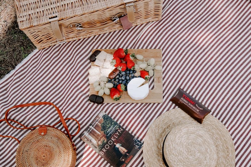 Brooklyn book near brown hat on textile