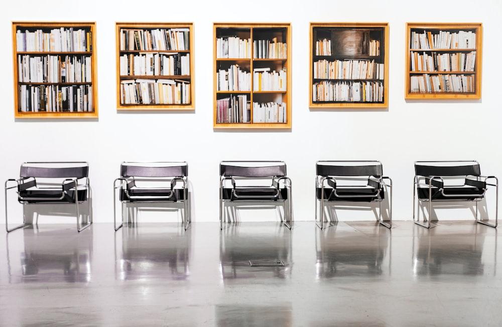 five brown bookcases