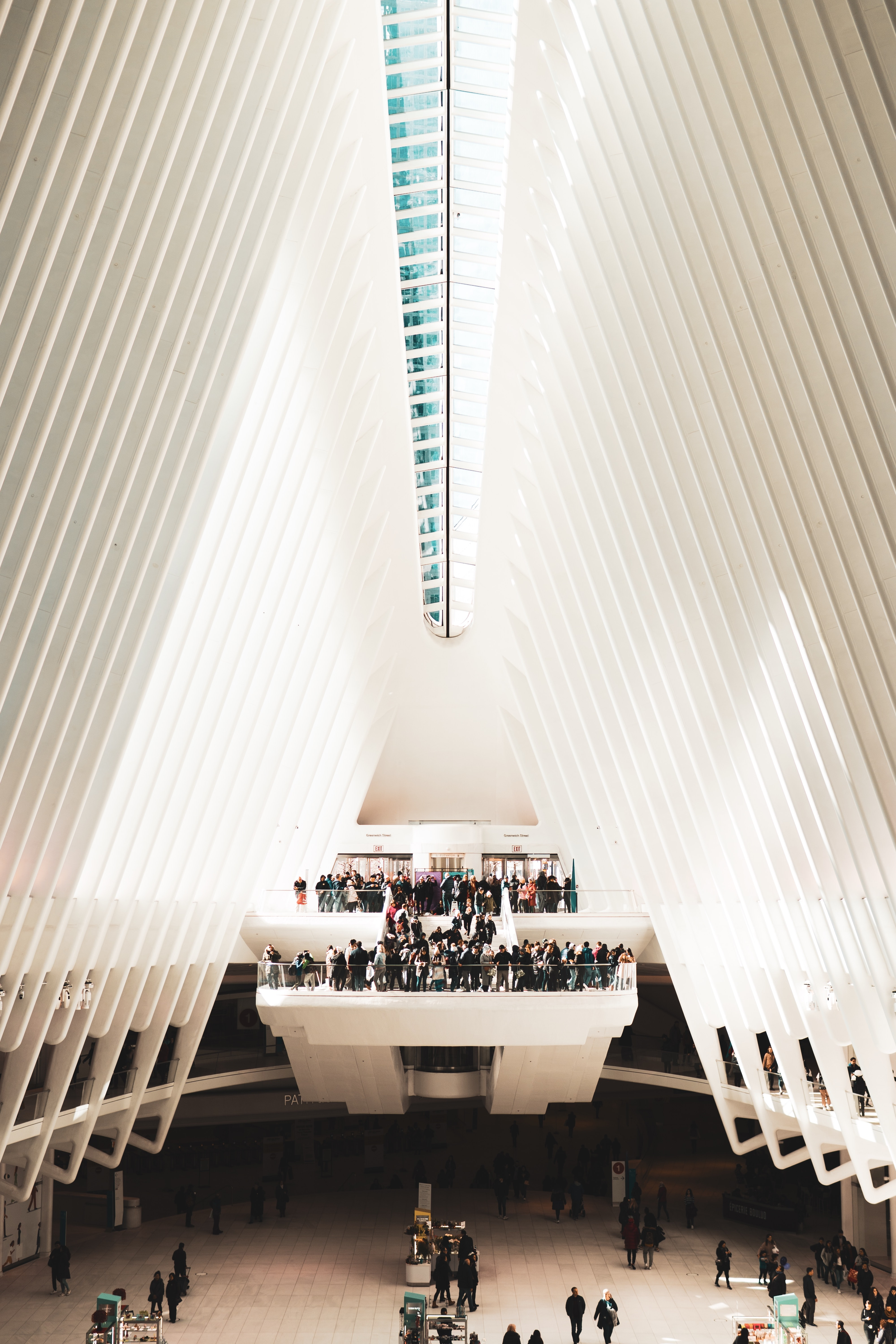 people inside white triangle-shaped building