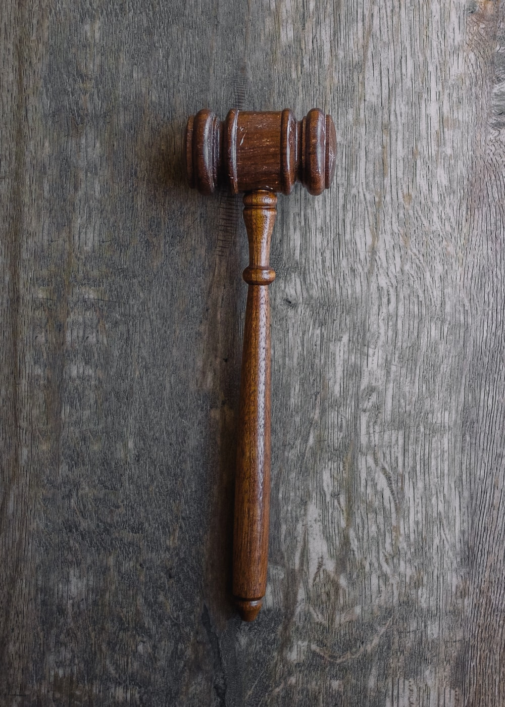 brown mallet on gray wooden surface