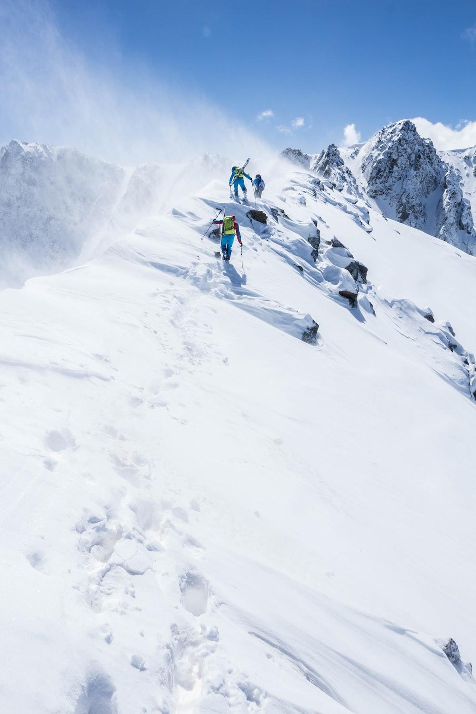 people skiing on snow ground