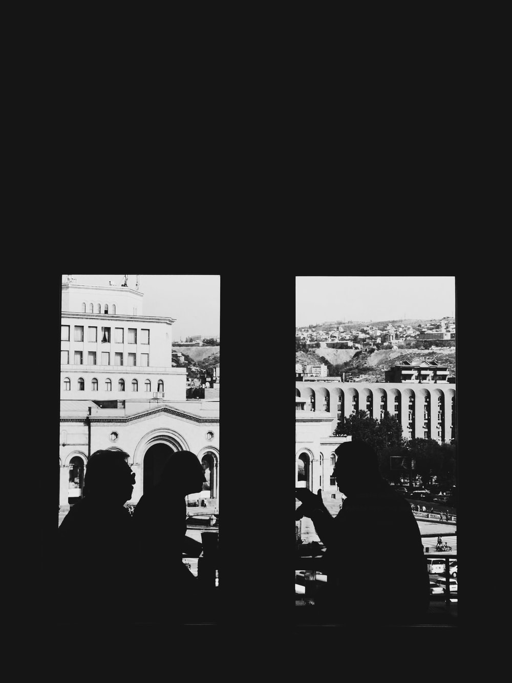 silhouette of people inside building
