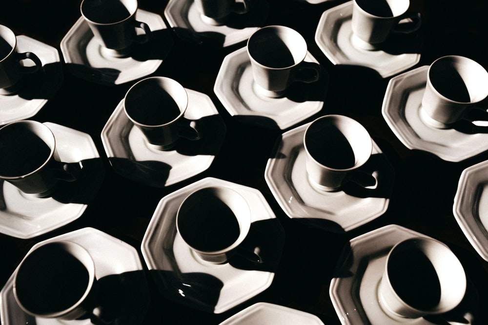white ceramic cups on saucers