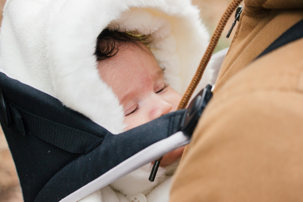 baby in white fur hooded jacket
