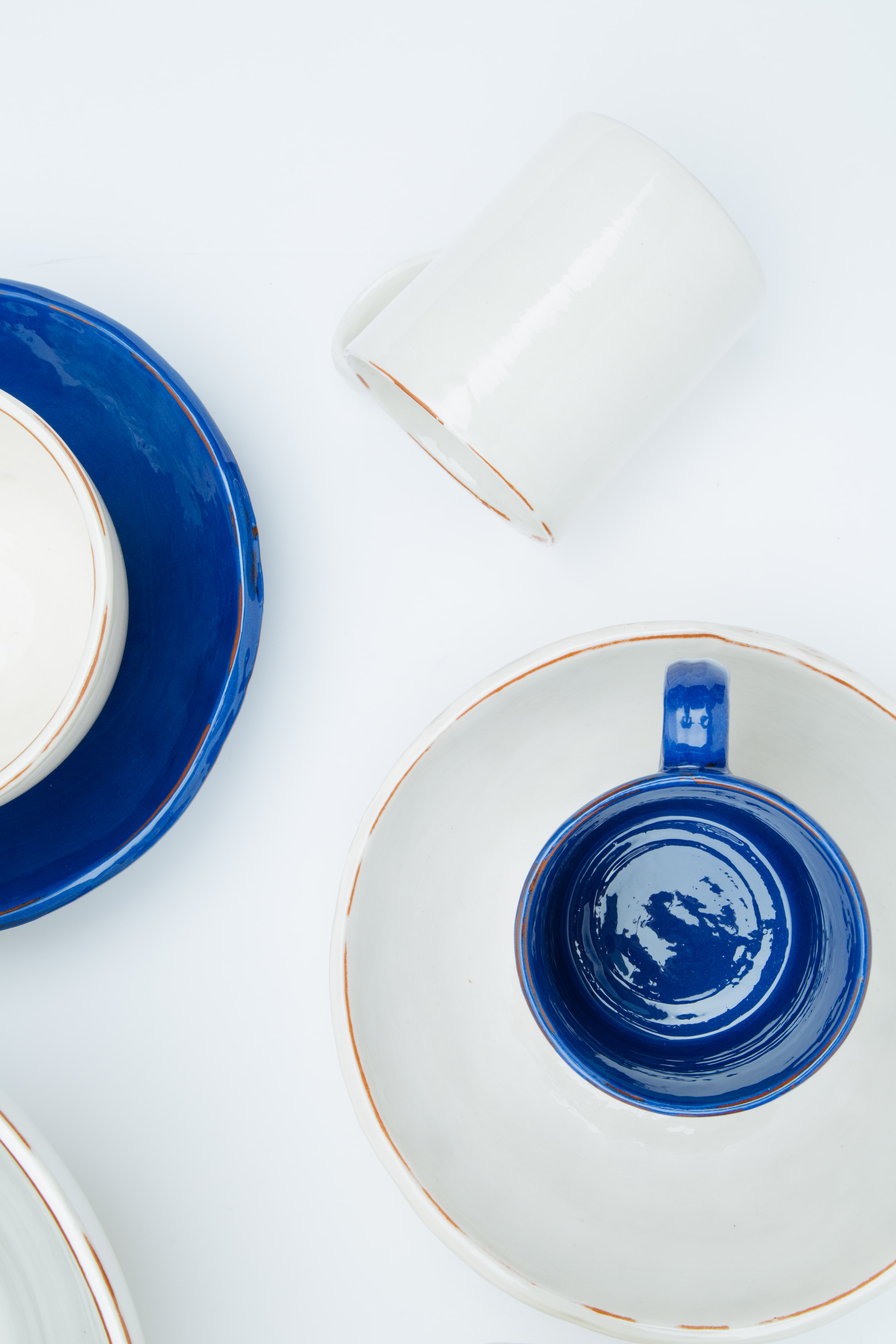 white and blue ceramic teacup and saucer
