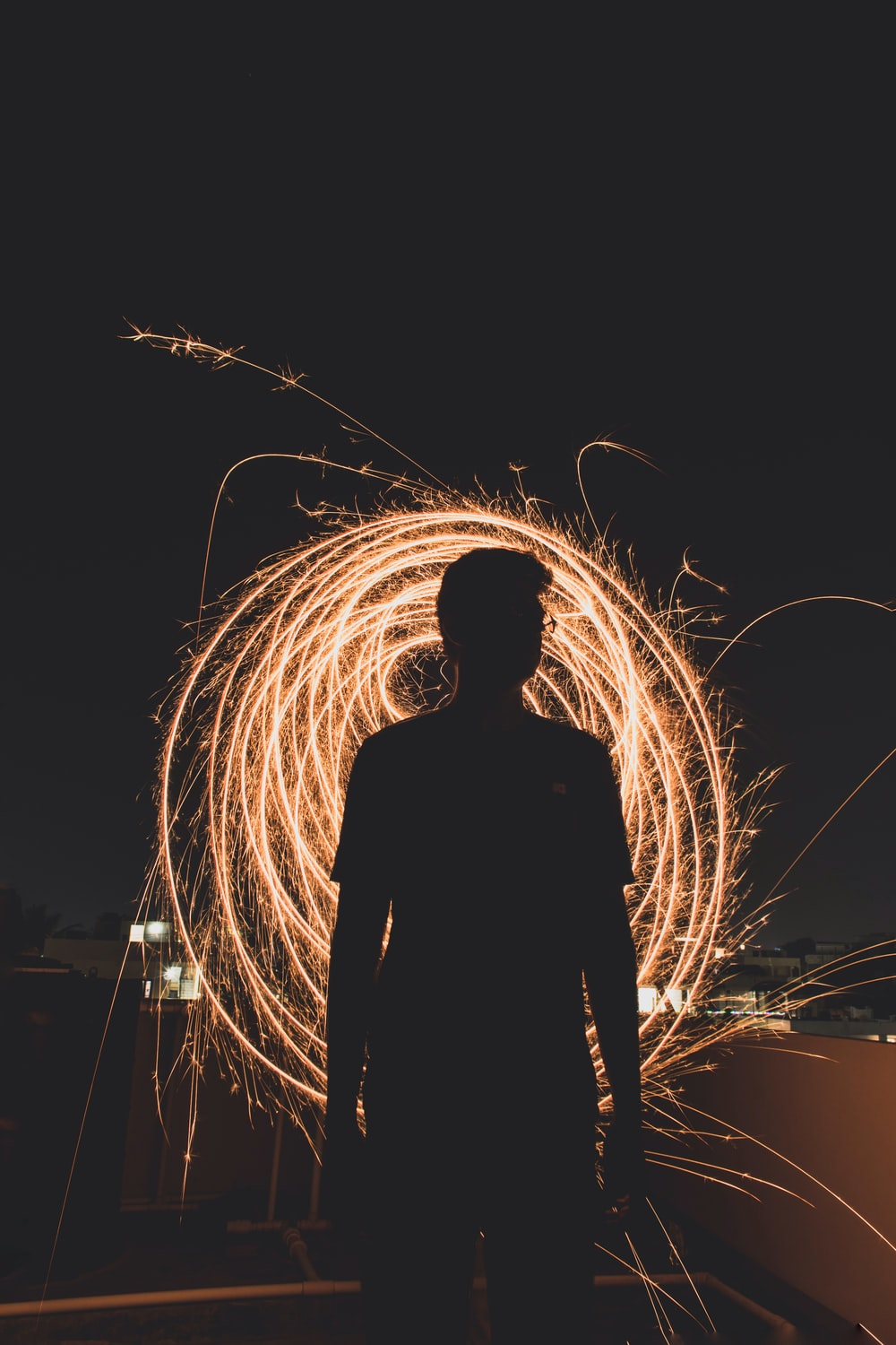 silhouette of man in front of steel wool photography