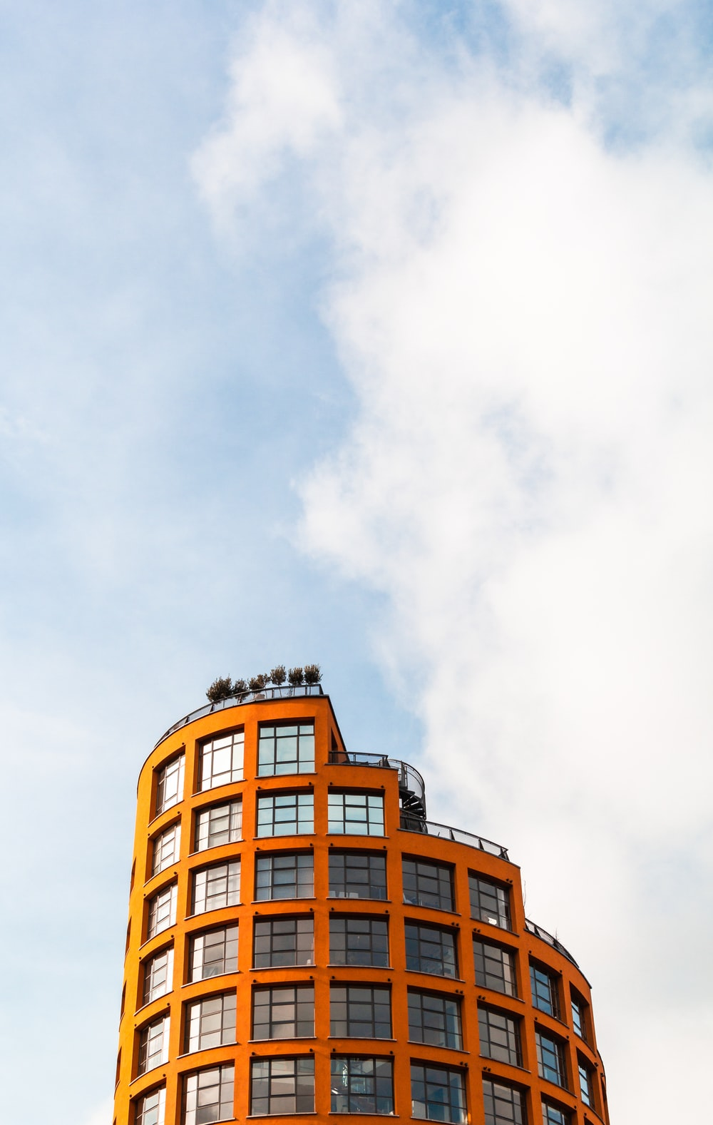 orange and clear curtain building during day time