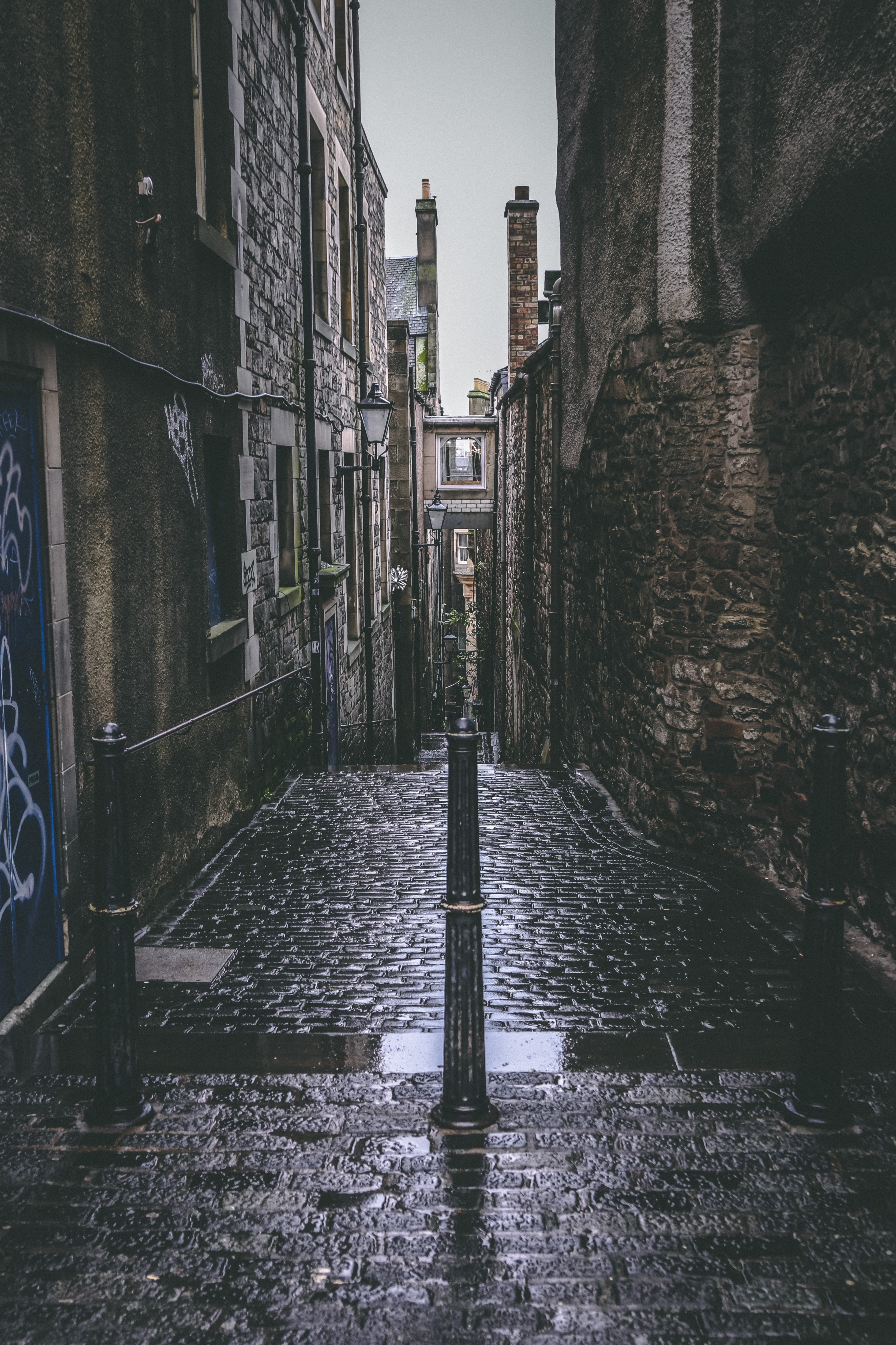 empty pathway surrounded by buildings