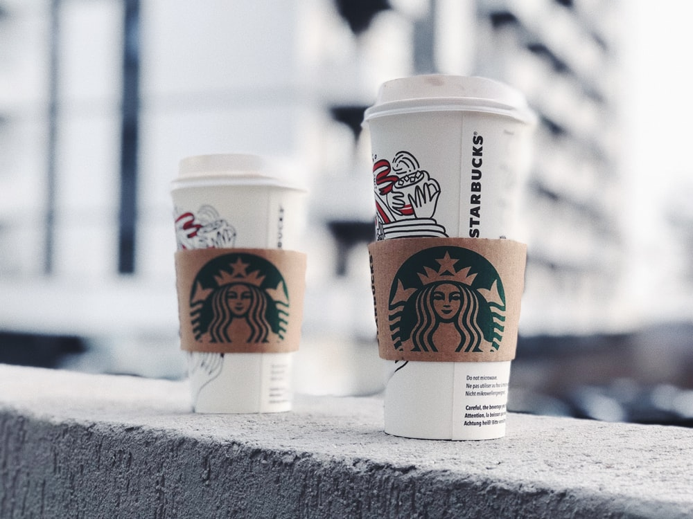 two Starbucks cups